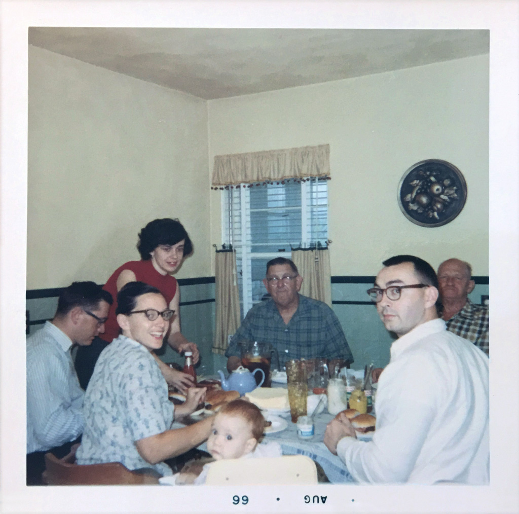 The Houston family eating hamburgers, August 1966