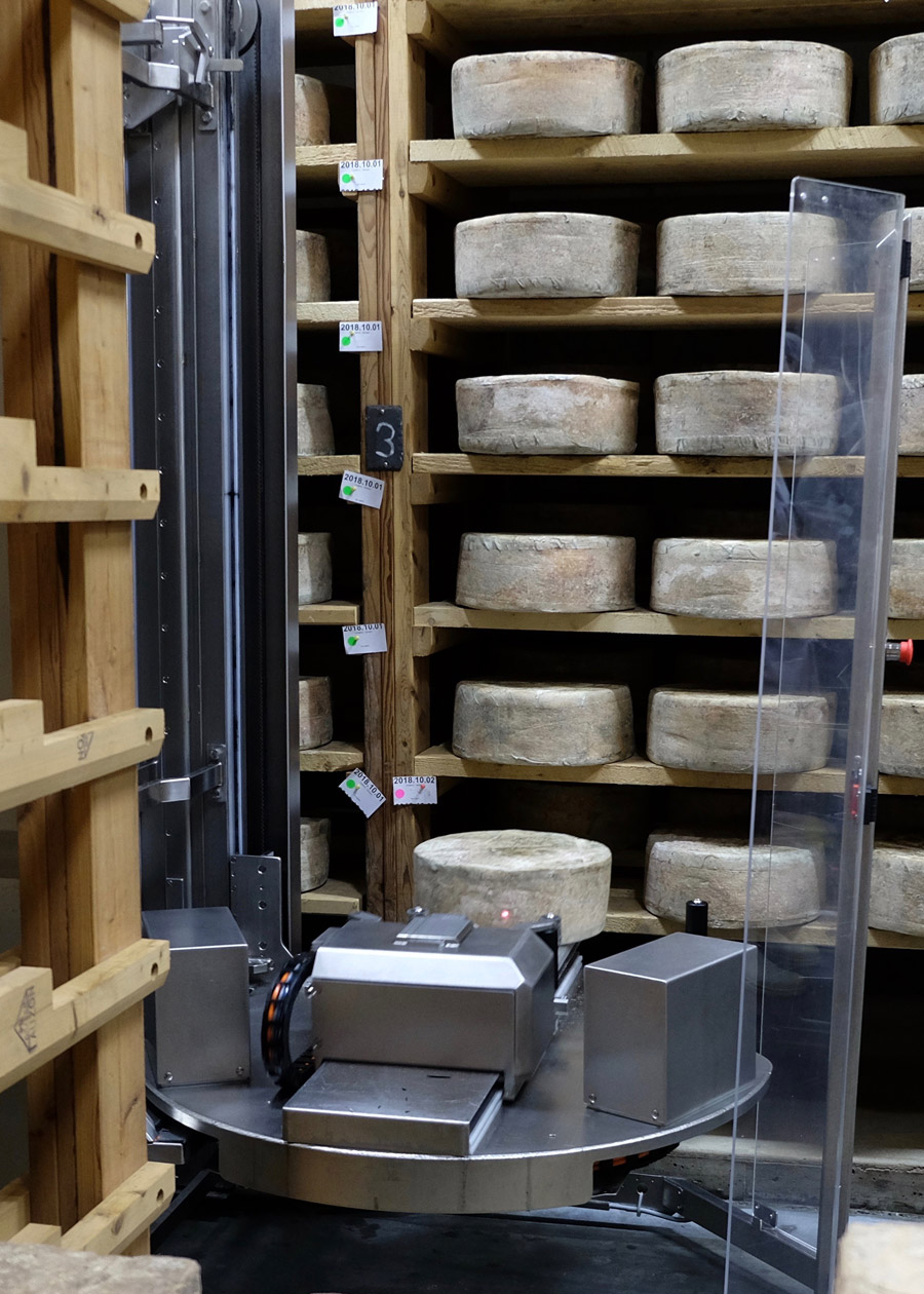 Cellars at Jasper Hill uses a robot to turn and brush the cheeses