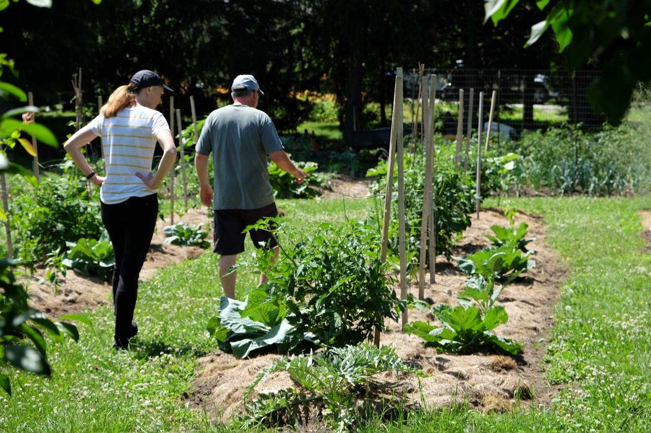 Brad Koehler showing the vegetable garden to Meg Houston Maker