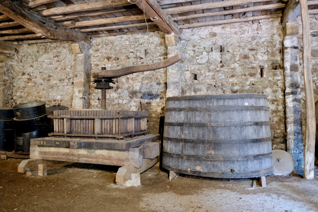 Historic press and tank at Château de Poncié