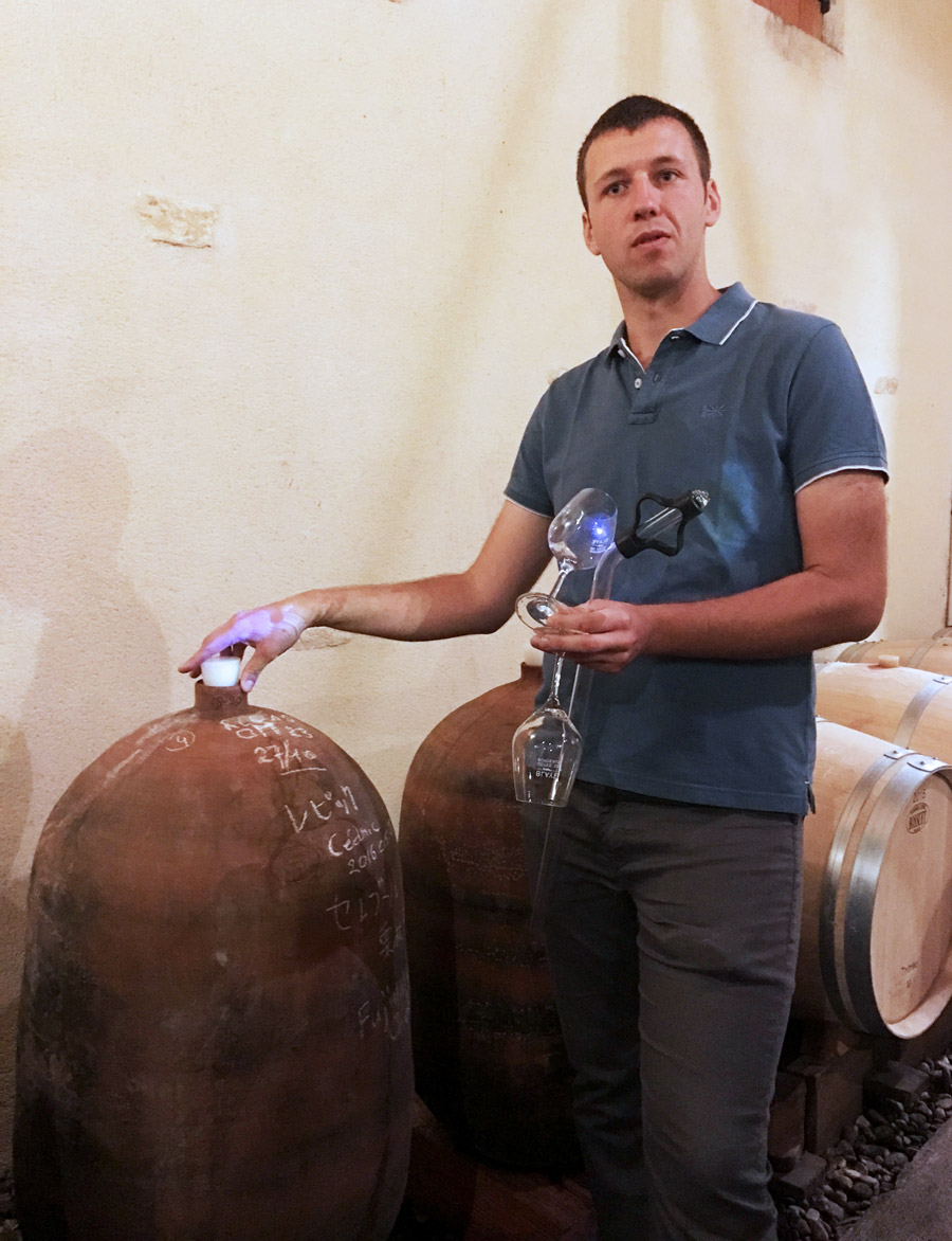 Guillaume Martin with amphorae in the cellar at Ch. Roland la Garde