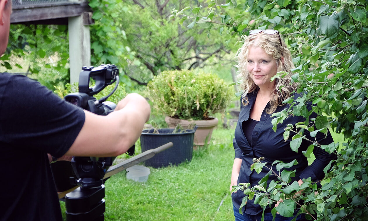Deirdre Heekin being filmed among her apple trees